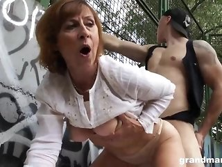 Grown up gal is deep-throating manstick in a public place and getting porked stiff, in return sex video