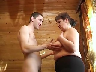 Fatty mature Irina seduces and fucks hard young mendicant